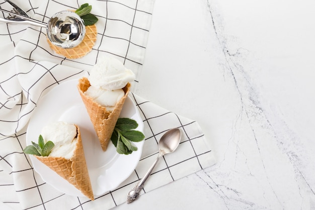 Delicious ice cream cones with mint leaves