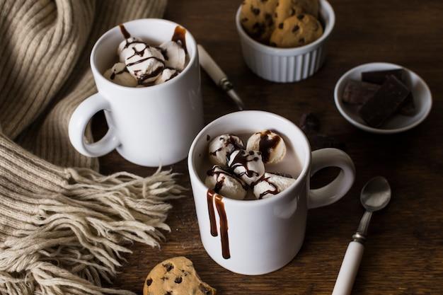 Delicious ice cream in mugs
