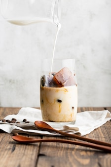 Delicious ice latte with milk ready to be served