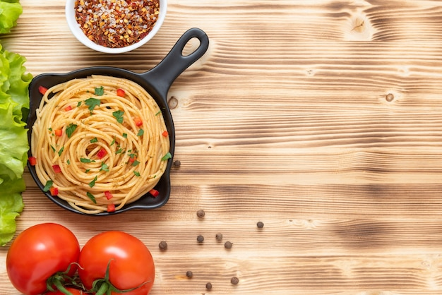 Delicious italian pasta with seasonings and herbs. copy the space. top view.