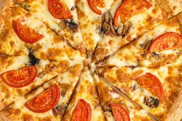 Delicious italian pizza made of tomato cheese and aromatic mushrooms champignons