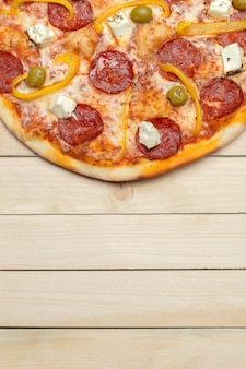 Delicious italian pizza served on wooden surface table