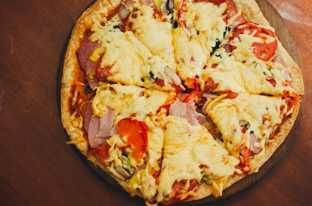 Delicious italian pizza served on wooden table in cafe, summer atmosphere