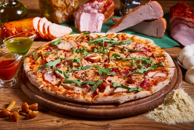 Delicious italian pizza served on wooden table. sliced pizza. tasty pizza composition