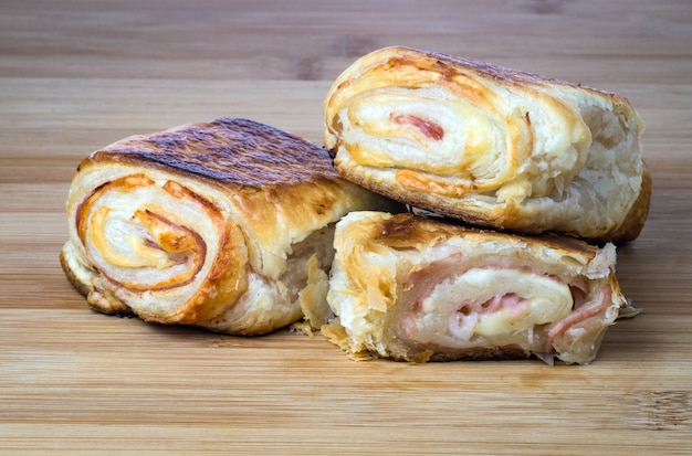 Delicious italian snack with puff pastry on wooden board