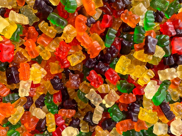 Delicious jelly bears. closeup a background from colorful sweets of sugar candies. assortment tasty gummy