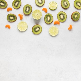 Delicious kiwi and lime slices with copy space