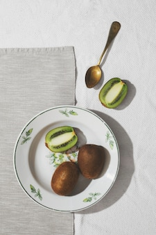 Delicious kiwi on plate top view