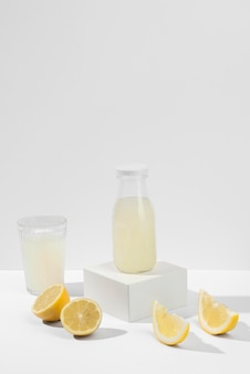 Delicious lemon juice bottle and glass