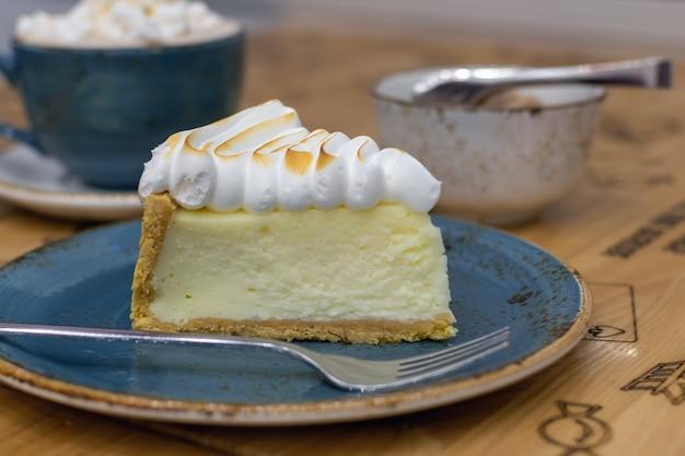 Delicious lemon tart with meringue closeup