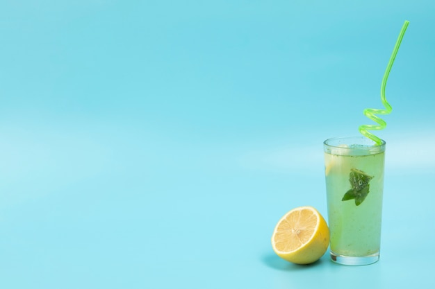Delicious lemonade on blue backgound with copy space