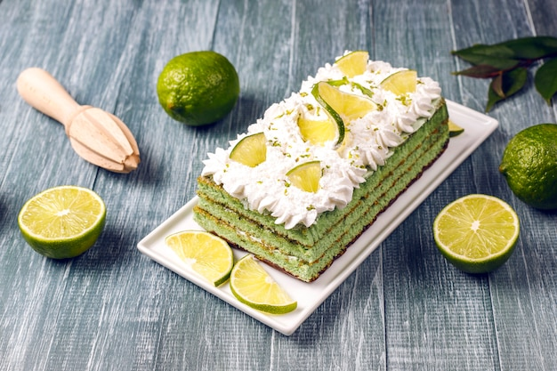 Delicious lime cake with fresh lime slices and limes