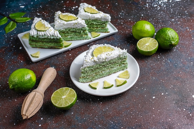 Delicious lime cake with fresh lime slices and limes.