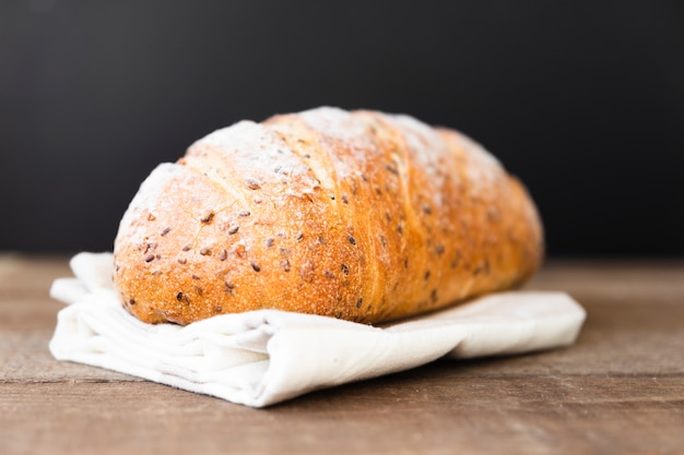 Delicious loaf of bread with seeds on the table