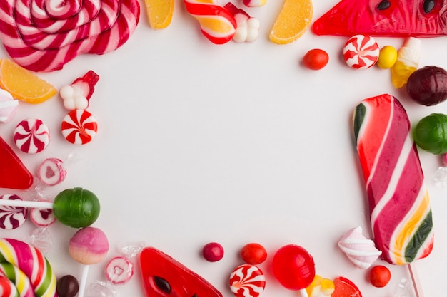 Delicious lollipops frame with copy space