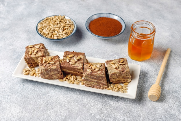 Delicious marble halva with sunflower seeds, cocoa powder and honey, top view