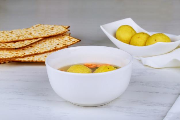 Delicious matzoh ball soup with matzah in a pot