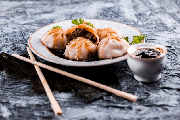 Delicious meat dumplings and sauce front view