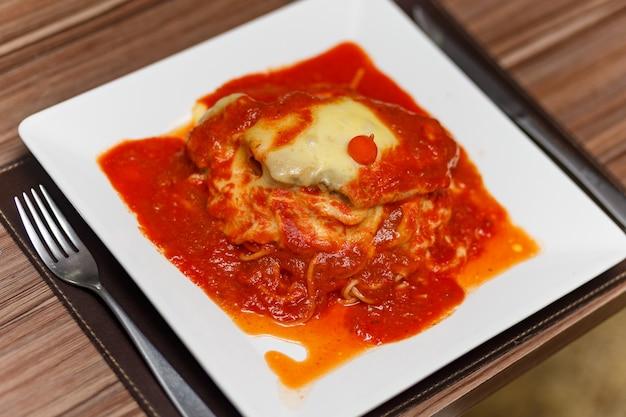 Delicious meat and pasta parmigiana dish