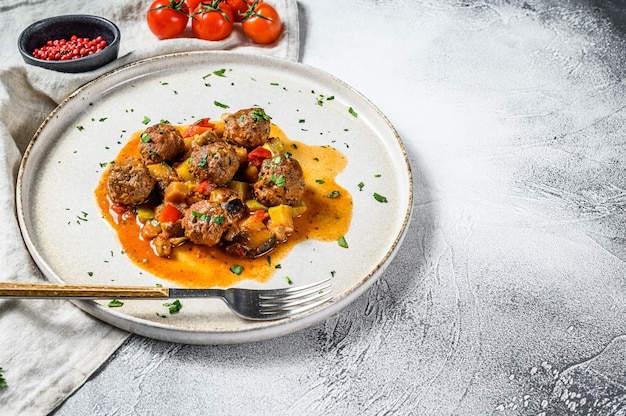 Delicious meatballs made from ground beef in tomato sauce, served in old metal pan. top view.