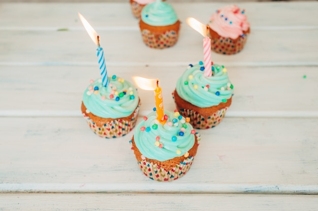 Delicious menthol muffins decorated with candles