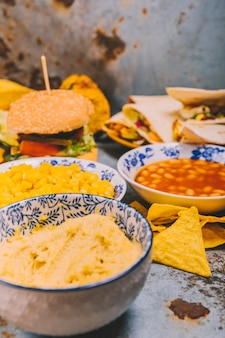 Delicious mexican dishes on rustic background