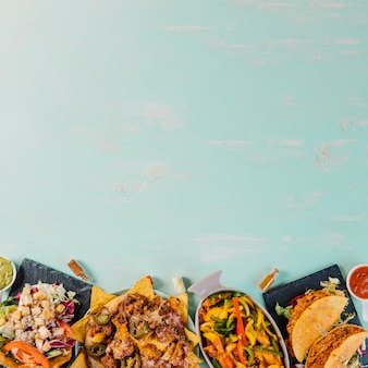 Delicious mexican food on blue background