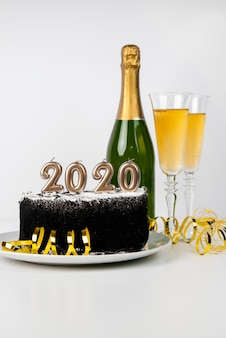 Delicious midnight cake and beverage 2020 new year digits