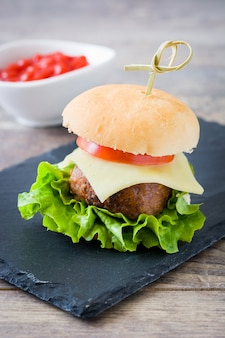 Delicious mini cheese burger with vegetables