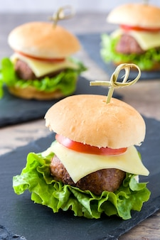 Delicious mini cheese burgers with vegetables