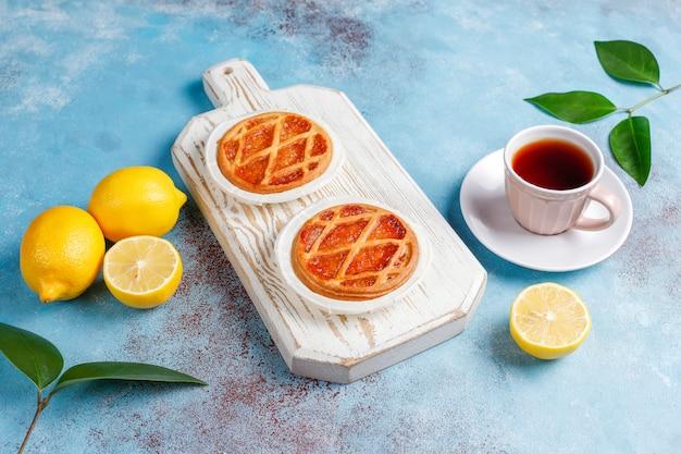 Delicious mini lemon pies with fresh lemons,top view