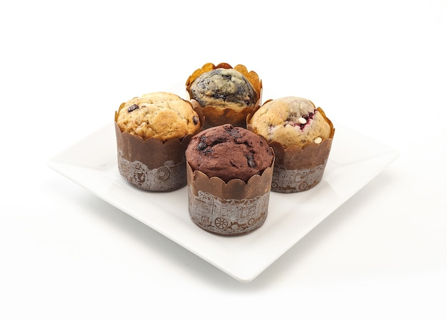 Delicious muffins on white background