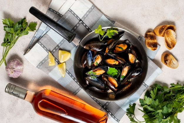 Delicious mussel shells with bottle of wine