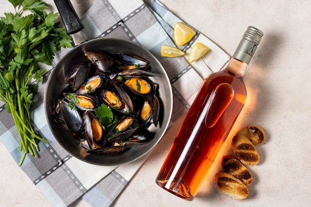 Delicious mussel with bottle of wine