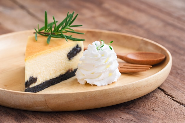 Delicious new york cheesecake with whipped cream. homemade bakery for cafe or birthday cake.