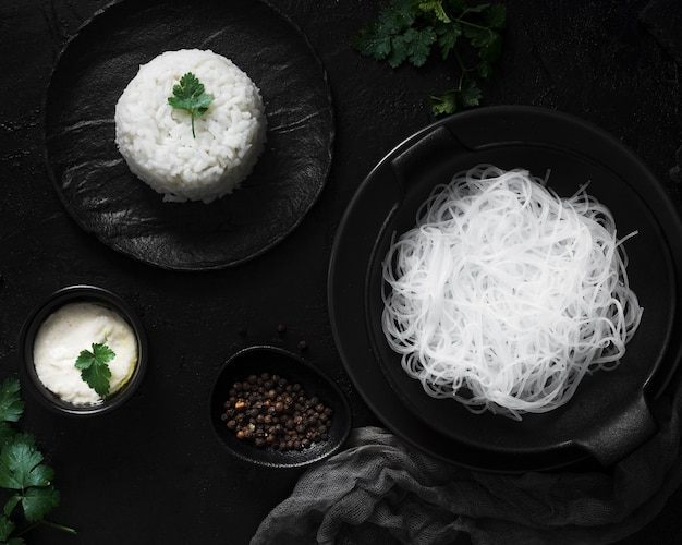 Delicious noodles and rice flat lay
