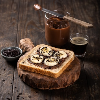 Delicious open sandwich with chocolate and banana
