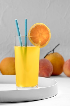 Delicious orange drink with straws