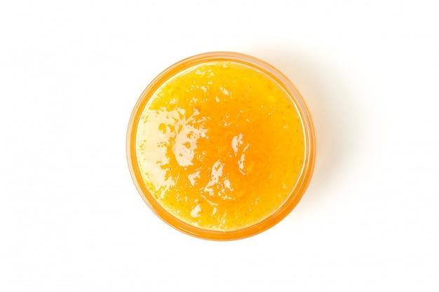 Delicious orange jam isolated on white