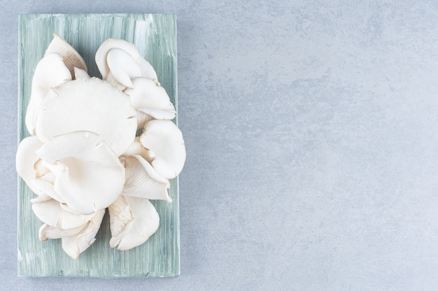 Delicious organic oyster mushrooms on gray background,.