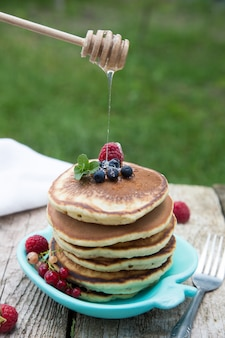 Delicious pancakes close up, with fresh berries