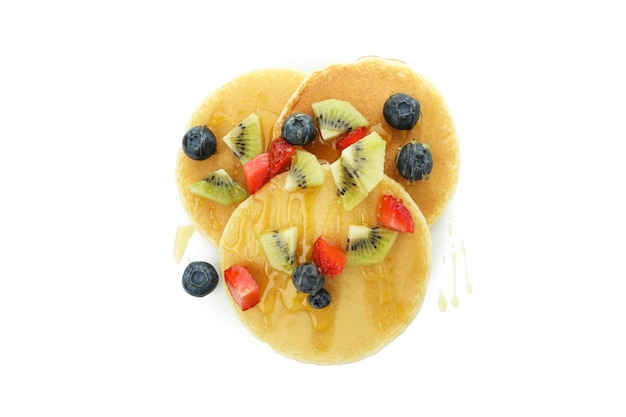 Delicious pancakes with berries and honey isolated on white background