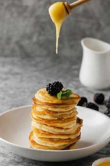 Delicious pancakes with blackberry and honey