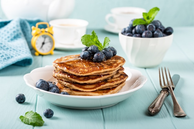Delicious pancakes with chocolate drops, honey and blueberries. healthy breakfast concept