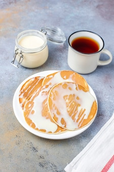 Delicious pancakes with condensed milk.