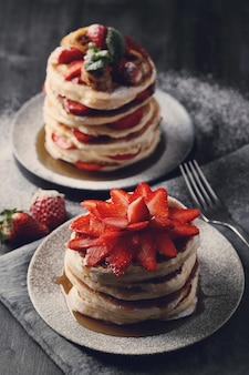 Delicious pancakes with fruit and honey