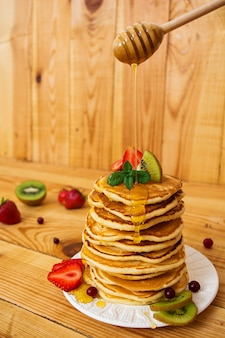 Delicious pancakes on wooden