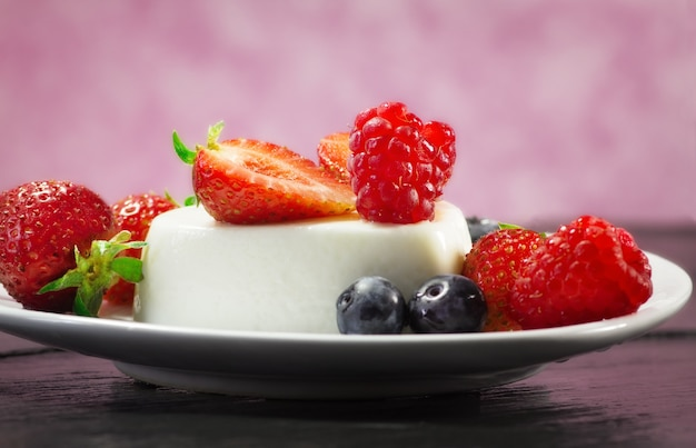 Delicious panna cotta with red fruits