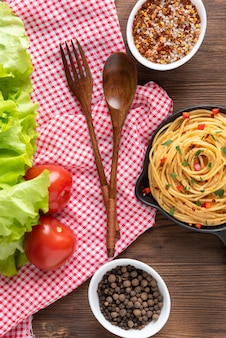 Delicious pasta with gravy and vegetables and seasonings.