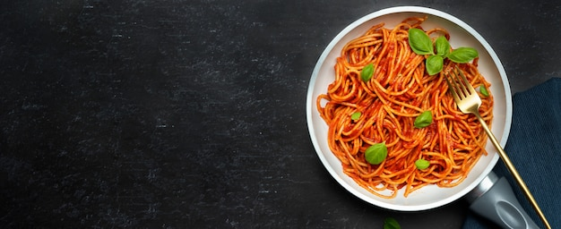 Delicious pasta with tomato sauce anf basil